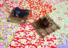 """I made Panda moors. The Japanese name is """"Panda demekin"""". They haven't strap. But I can attach strap free. And I give coaster of the bamboo to buyer.  ●The black panda moor size is approx 3.5inch×2.7inch  ●The orange panda moor size is approx 3.1inch×2.4inch  If you are interested, please do have a look:) https://www.etsy.com/listing/221420512/panda-goldfish?ref=shop_home_active_8"""