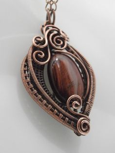 Red Tiger Eye Wire Wrapped Copper Pendant by PerfectlyTwisted Wire Pendant, Wire Wrapped Pendant, Wire Wrapped Jewelry, Pendant Necklace, Handmade Wire Jewelry, Handmade Necklaces, Beaded Jewelry, Jewellery, Antique Copper