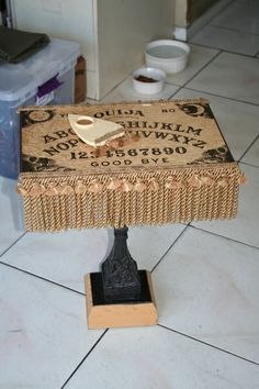 A Ouija Board table.  This would be cool to make as a display for cookies or cupcakes for a party.