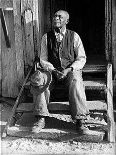 Sitting on the steps: Photo taken of Henry Brooks in 1941, an ex-slave, in Greene County Georgia in 1941.