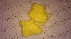 Made to order Preemie sized booties can also be used as party favors filled with small bite sized candies for a baby shower.