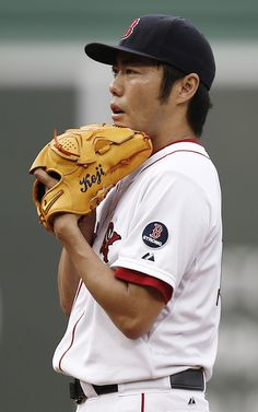 "Koji Uehara #19 of the Boston Red Sox pitches against the Chicago White Sox during the ninth inning at Fenway Park on September 1, 2013 in Boston, Massachusetts.(LOVE THE ""KOJI' ON THE GLOVE)"