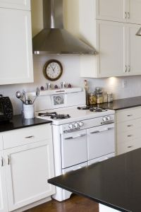 Love the vintage stove in the modern kitchen.