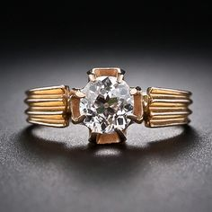 Antique .85 Carat Cushion-Cut Diamond Solitaire - Victorian 14 karat rose gold ring features a sparkling .85 carat antique cushion-cut diamond set with eight pointed prongs. The wide shank is fluted and tapers slightly towards the base.