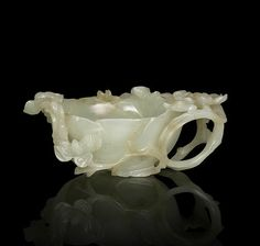 A pale green jade 'lotus' brush washer, 17th century