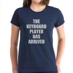 THE KEYBOARD PLAYER HAS ARRIVED -- LARGE LETTERS T