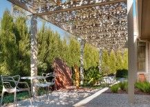 A wall of cypress trees borders a Houston patio