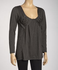 Boasting pretty pleated details along a generously scooped v-neck, this trend-savvy top embodies easy elegance. With its feminine, flattering fit and hint of stretch from elastane, this breezy top is destined to become a front-of-the-closet favorite. Measurements (size M): 28'' long from high point of shoulder to hem95% polyester / 5% elastane