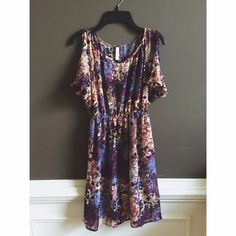 ✨Xhilaration✨ Sheer Floral Dress This sheer floral dress has an elastic waist, short sleeves with should cut outs and is lightweight! It is see through so has to be worn with a slip! I had a purple one that looked great! Make me an offer!  Xhilaration Dresses