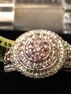 Silver Ring With Small Diamond Chips Around The Halo