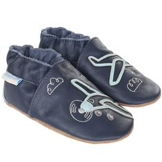 ff12a6300733 A navy leather soft sole with appliqué airplanes
