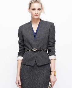 "All you need is tweed this season, especially when tailored with a collarless silhouette and cropped cut. Worn head-to-toe or mixed-and-matched, it's one of the season's most sophisticated looks - especially when topped off with a polished belt. Long sleeves with functional sleeve buttons for added styling options. One-button front. Front besom pockets. Lined. 20 1/2"" long."