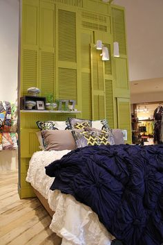 Fun idea. vintage shutters painted as wall art