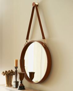 """Round """"Havana"""" Mirror at Horchow.  Round wall mirror with leather frame hangs from a long leather strap for a pendulum effect...24"""" diam.  could I do this myself???"""