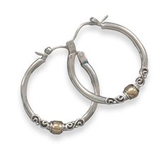 21mm sterling silver hoop earrings with a 4mm 14 karat gold plated bead.