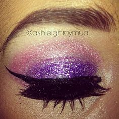 Pink with purple glitter, winged eyeliner and false eyelashes
