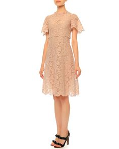 Valentino lace dress. Jewel neckline. Flutter sleeves. Fit-and-flare silhouette. Scalloped trim at sleeves, natural waist, and hem. Hidden back zip. Cotton/viscose/nylon. Made in Italy.