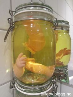 "Jars + tinted water + doll parts = Creepy ""Specimen"" decorations for halloween"