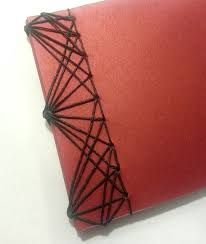 The binding on this one reminds me of a spider web. again i like the red and black colors and i think this book is well put together.