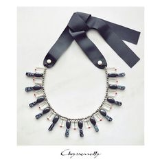 - Chryssomally statement ribbon necklace with gray hematite and snowflake obsidian stones, white pearls and red, silver and clear crystals. Hematite Necklace, Crystal Necklace, Obsidian Stone, Ribbon Necklace, Snowflake Obsidian, Semi Precious Gemstones, Clear Crystal, Fashion Art, Swarovski Crystals