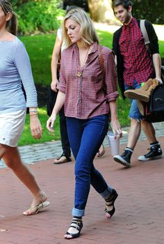 """Drew Barrymore wears a pair of skinny jeans and carries a beverage on the way to the set of her latest film """"Going the Distance.""""."""