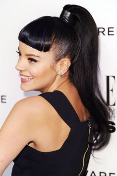 We're not sure what part of Lily Allen's ponytail we love more: the latex-black-tape accent or the blue-tinted middle bangs.