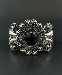 Black and Silver Spring Open Style : http://www.outbid.com/auctions/2266-come-if-you-dare-yesterday-s-jewelry-auction#29