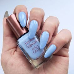 Barry M Coconut Infusion Review, swatches on natural nails - Barry M Laguna. Cornflower blue nails.