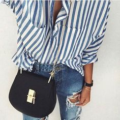 Blue striped shirt, skinny jeans, black crossbody bag
