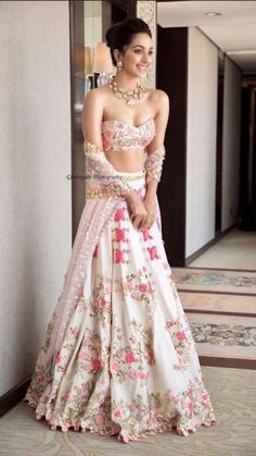 Kiara Advani looks like a complete charmer in this ivory riveted floral lehenga with metal sequins & bangle embroidery. Call/WhatsApp for Purchase Inqury : Indian Lehenga, Pakistani Bridal Lehenga, Red Lehenga, Lehenga Choli Wedding, Designer Bridal Lehenga, Pakistani Suits, Sabyasachi, Indian Wedding Outfits, Bridal Outfits