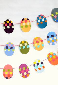 """Woven Paint Chip Easter Banner: Skip the typical """"Happy Easter"""" banner for several string egg banners that are made out of paint chip samples. Click through for more Easter party ideas and decorations that your kids and family will love. Easter Arts And Crafts, Spring Crafts, Holiday Crafts, Happy Easter Banner, Easter Garland, Diy Banner, Easter Activities, Preschool Crafts, Easter Colors"""