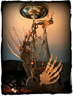 Haunted Halloween Hallows Tablescape with decorated chandelier overhead. Golf Halloween, Halloween Clay, Haunted Halloween, Halloween Table, Halloween 2018, Halloween House, Skeleton Decorations, Scary Halloween Decorations, Halloween Themes