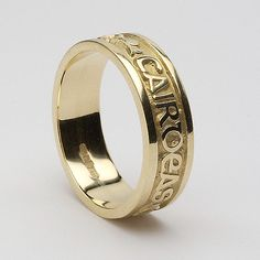 Blanaid Celtic Wedding Ring (C-38). But with my name and the date on the outside, different and sweet.