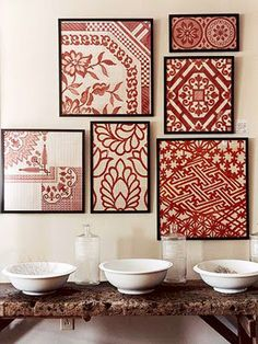 Notice again what ties this collection together: identical black frames and the red and white coloration of the fabrics.
