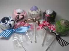 """It's a Onesie & Pair of Socks made into a """"Sweet"""" Lollipop!    Each Lollipop includes:    (1) Name Brand Onesie, Size 3-6 months  (1) Pair of Socks, Size 0-6 months  (1) Handmade Baby Tag"""