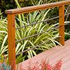 I like this deck railing... would be able to actually see the kids playing in the yard while sitting on the deck.
