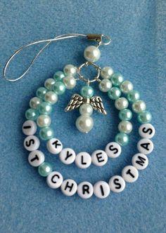 Baby 1st Christmas ornament similar to hospital baby bracelet of old.