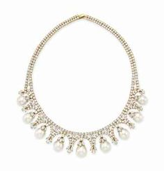 A CULTURED PEARL AND DIAMOND NECKLACE, BY CHANTECLER The front suspending a series of graduated drop-shaped cultured pearls, each to the marquise-cut diamond cap, spaced by marquise and circular-cut diamond fringe detail, to the circular-cut diamond neckchain, mounted in 18k white gold.