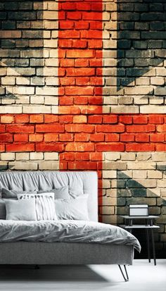If you're feeling patriotic and want a striking feature wallpaper in your home then choose this amazing Union Jack on Old Brick wall mural! This stand out feature wall will look incredible in a funky man cave, bachelors bedroom or game room! Style with all grey furniture such as this light grey bed. Add black accent pieces for contrast and paint surrounding walls in navy for a darker feel or off white for a brighter room! Find this mural and more at Wallsauce.com!