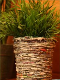 Using a yogurt container and rolled up newspapers you can make this cute little planter
