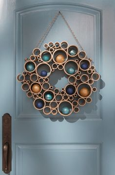 I could totally make this.  Tubes. Spray paint. Ornaments.