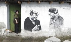 Staro Zhelezare, Bulgaria Ivanka Toneva enters her house next to a mural depicting her husband, Krustyo Tonev, and the German chancellor Angela Merkel