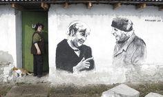 Staro Zhelezare, Bulgaria Ivanka Toneva enters her house next to a mural depicting her husband, Krustyo Tonev, and the German chancellor Angela Merkel