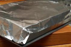 Faster trick for lining a pan with foil!! When you need to line your pan with foil, flip it over and wrap it around the bottom of the pan first, then insert that into the pan. Faster then doing it from the top and way neater. I always pushed too hard and punched a hole in the corners before this tip.