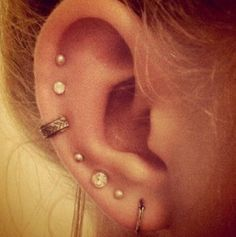 Ear piercings  I kinda want my ears to look like this!:)