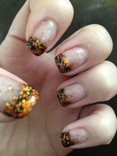 "The Crazy-Simple Glitter Manicure | 25 Clever Nail Ideas For Halloween - these remind me of katniss' and Peeta's parade costumes in ""Catching Fire"""