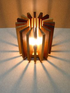 A lamp made from recycled wooden pieces recovered from a carpenter's workshop. It is composed of seventeen pieces of many kinds of wood – those which remai