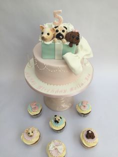 Puppy birthday cake for a little girl with a pug, chihuahua and a maltipoo. Matching cupcakes too by Sweet Bea's Bakery