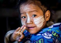 Beautiful young girl with thanaka at a school near Kalaw, Myanmar. — at Kalaw, Shan State, Myanmar - burma.
