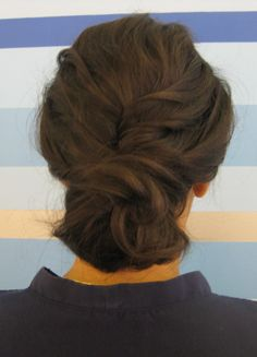 Emily's hair will be done in a simple up-do.